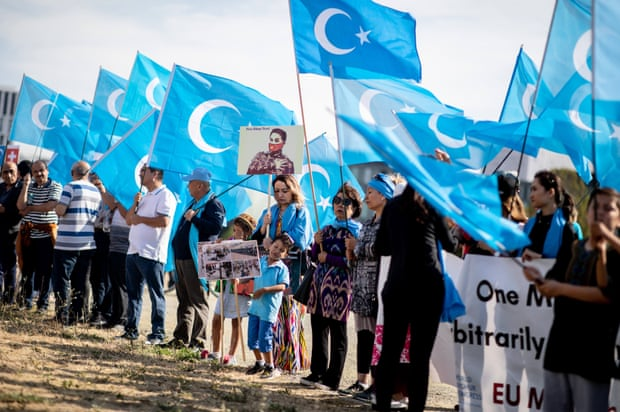 People around the world are beginning to protest against China's treatment of the  Uyghurs. Berlin protestors showed their support by holding East Turkestan flags. Photo Credit: Kay Nietfield