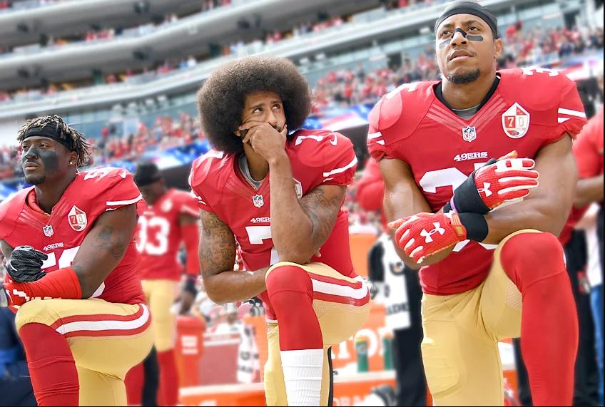 Kaepernick+kneeling+alongside+49ers+teammates+Eli+Hardold+and+Eric+Reid+during%0Athe+national+anthem+of+a+2016+game.+Kaepernick+has+not+played+since+that+season%0A