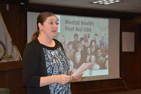 Badders discusses warning signs of suicide at a Mental Health First Aid USA course for U.S. Army Materiel Photo credit: Rachel Ponder