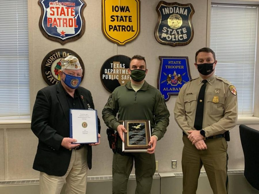 Lieutenant Commander Tim Mullin (right) standing with the American Legion's Northern Central District Officer of the Year Award winner (middle). Photo Credit: Facebook, Maryland State Police, Bel Air Barrack