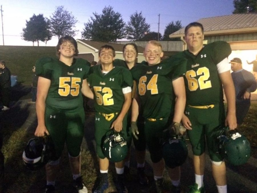 Junior Ben Sersen, number 52, posing with his teammates.  The photo was taken during the last season the team was together.