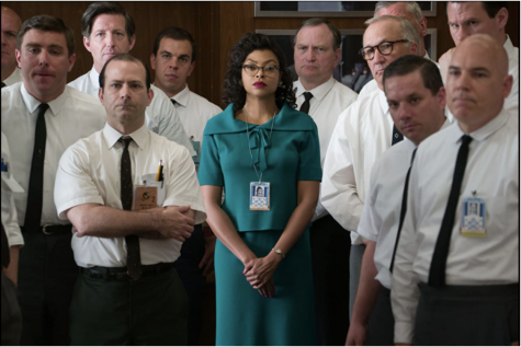 Katherine Jonson played, by Taraji P. Henson, stands among her co-works listening to an announcement while at work. The movie 'Hidden Figures' is based off real events that happened in 1961.
