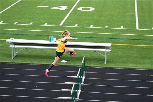 Sophomore Stephanie Erisman completing hurdle jumps. Erisman won first place in a track event on May 5th.