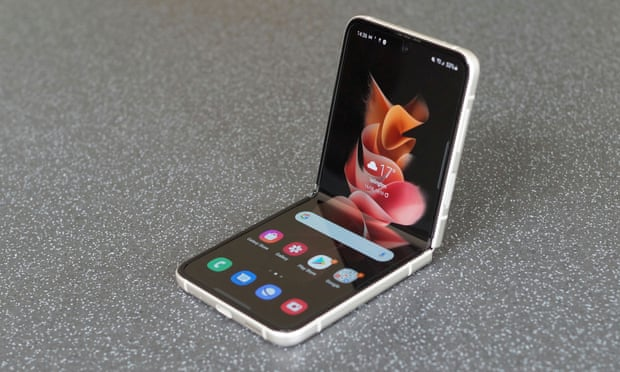 The new Samsung Z Flip 3 shown on display with its flip phone capabilities. Samsung continues to bring new cards to the table with new and improved foldable smart devices.