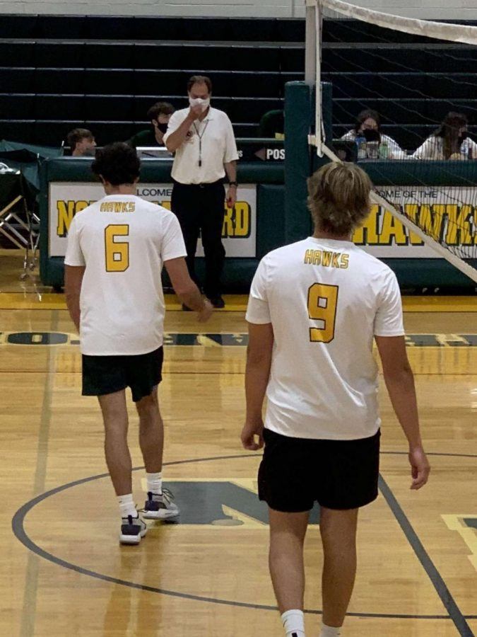 Senior Vance Haire (Left) and Senior Ryan Tracy (Right) take the court after their first set-win, North Harford would fall short to the Mustangs by a score of 3-2.