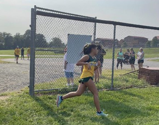 Valentina Angulo running at the Patterson Mill High School meet. She placed fifth overall for the race.