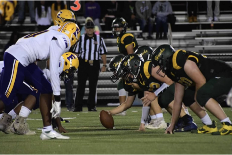 The Hawks face their opponent at the line of scrimmage. The team prepares to make an attempt for another first down.