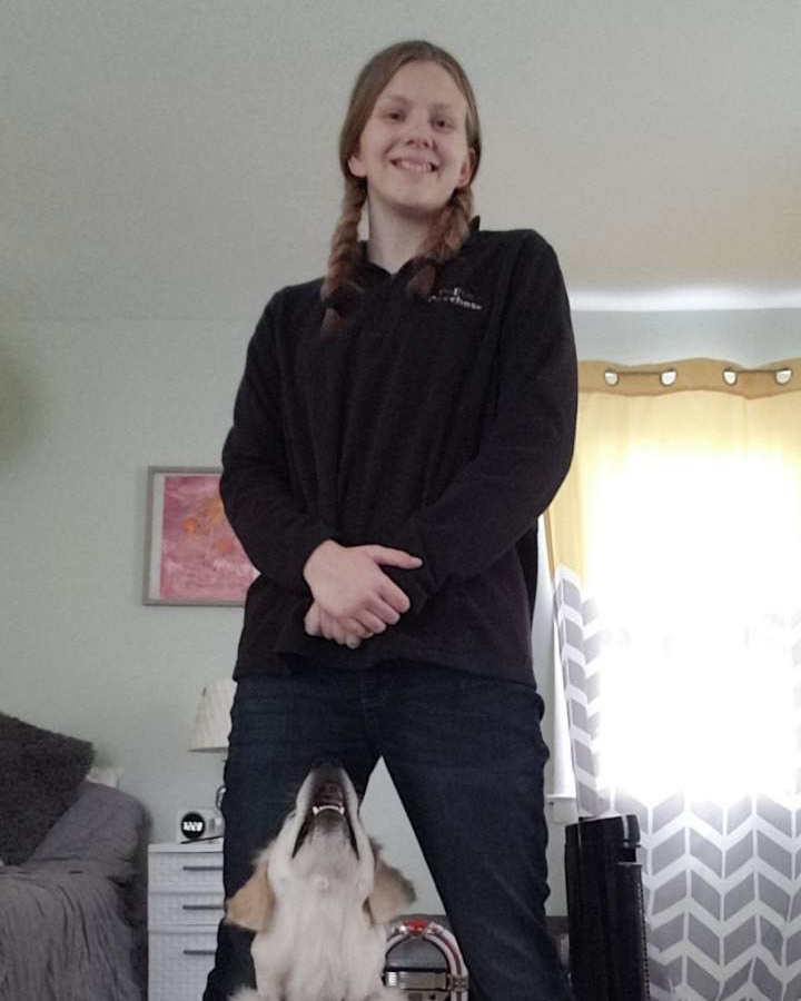 Junior+Stephanie+Erisman+posing+in+her+volunteer+uniform+for+Polite+Pooches+with+her+dog+Harper.+Erisman+volunteered+at+Polite+Pooches+because+she+loves+dogs+and+considered+dog+training+for+a+future+career.+%0A